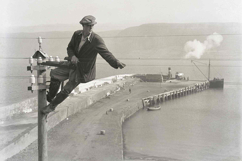 Engineer on a telegraph pole at Waterfoot Harbour, Northern Ireland. 1936.