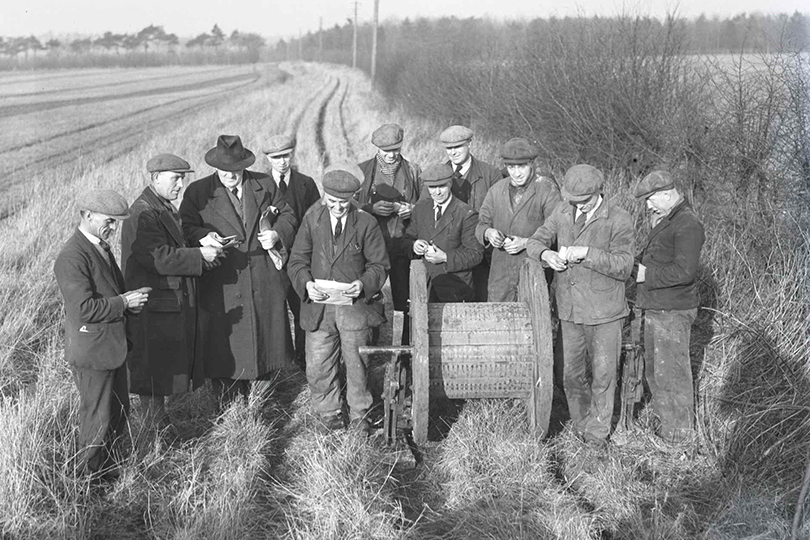 Engineers receiving pay for laying temporary cables following the death of George V. 1936.