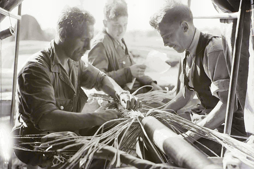 Engineers soldering and jointing telephone cable. 1945.