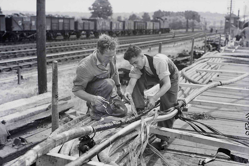 Engineers working on cables near the Severn Railway Tunnel, Gloucestershire. 1940.