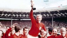 England captain Bobby Moore holds the Jules Rimet Trophy aloft after the 4-2 win over Germany.