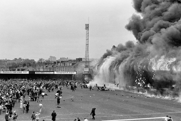 Fans flee the fire in the stand at Valley Parade.
