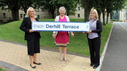 University of Bath staff with the sign that was returned more than a decade after it first went missing (University of Bath/PA)