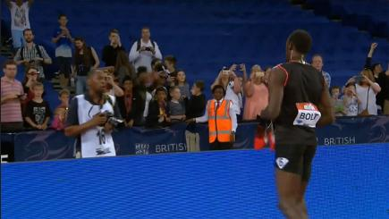 Fan catches Usain Bolt's shoes...then weeps!