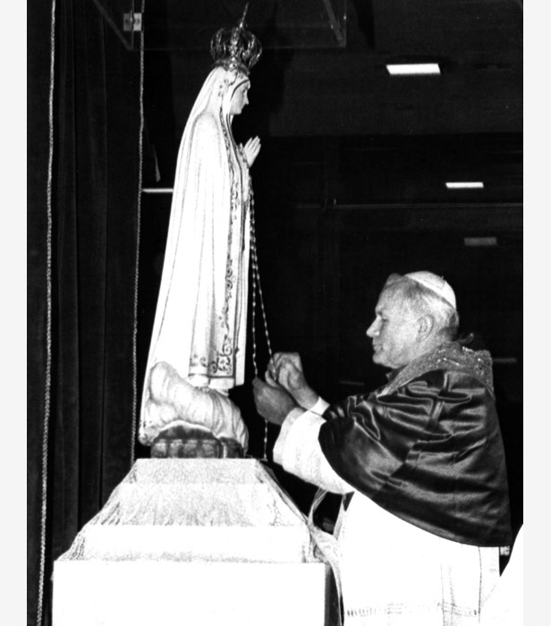 Pope John Paul II prays in front of the statue of the Virgin Mary at the Chapel of the Apparitions in Fatima, May 12, 1982.