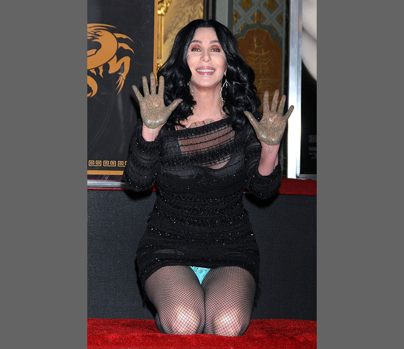 Faux-pas or on purpose? We're not sure, but Cher made sure her handprint ceremony in LA was memorable in more ways than one!