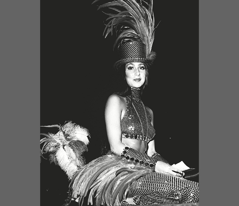 Feathers and sequins, it's all in a day's work for Cher in 1974.