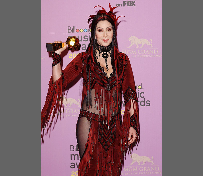 Feathers, fringing, beading - Cher mixes it all together in 2002.