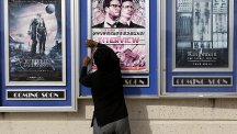 A poster for The Interview is removed from a display case at a Carmike Cinemas theatre in Atlanta, Georgia (AP)