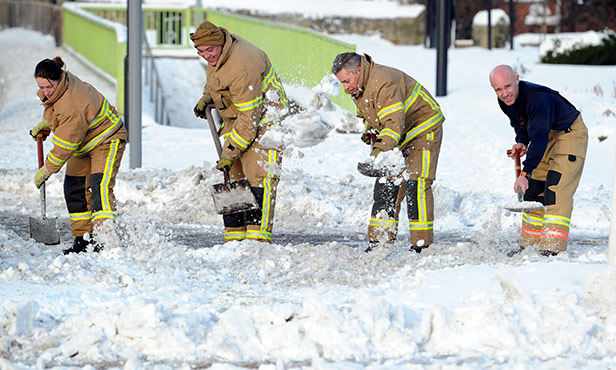 Fire fighters clear the snowdrifts