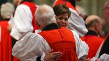 The Rev Libby Lane hugs a member of the clergy during a service at York Minster, where she was consecrated as the eighth Bishop of Stockport in a historic move ending centuries of all-male leadership in the Church. (PA)