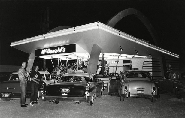 Customers visit McDonald's in Des Plaines on its opening night in April 1955.