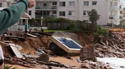 Floodwaters leave three people dead as storms lash Australia's east coast
