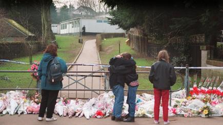 Floral tributes lie at the gates of Dunblane Primary School in the days after the massacre