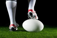 Foot on rugby ball