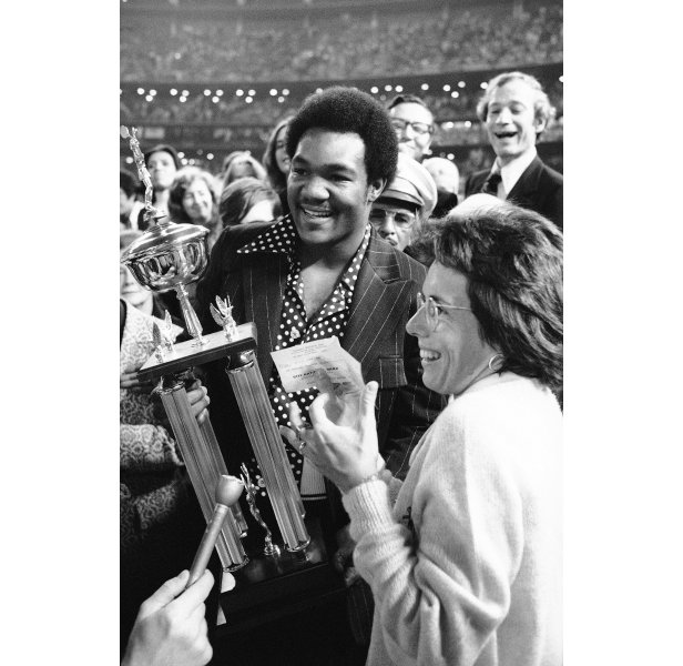 World heavyweight boxing champion George Foreman presents the trophy and a $100,000 cheque to King.