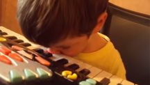 Four-year-old plays keyboard with his nose