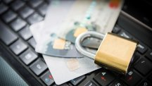 Credit cards and padlock on laptop keyboard
