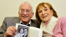 Freddie Knoller, 93, who was born in Vienna in 1921, with a picture in his book of his wife Freda who he married in New York in 1950, as he talks of his memories of the Jewish Holocaust at a centre for victims in north London