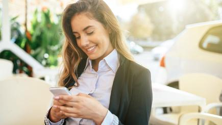 Woman looking at phone and smiling