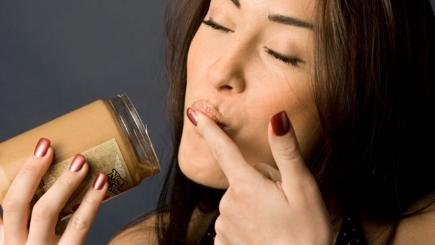 Woman eating peanut butter