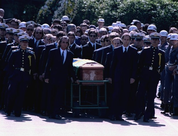 Among Senna's pall bearers were Brazilian F1 great Emerson Fittipaldi (to the left of the coffin) and former McLaren teammate Gerhard Berger (right).