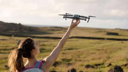 Woman with drone in sky