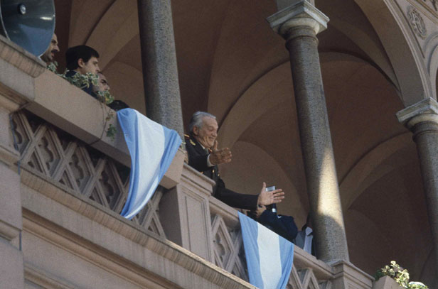 Argentina's President Leopoldo Galtieri waves to supporters from the balcony of the Government Palace in Buenos Aires.