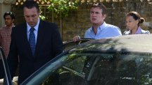 Alfie Moon is led away in an unmarked police car