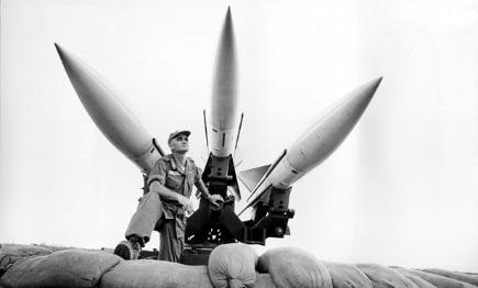 General William Westmoreland, commander of US Forces in South Vietnam, stands beneath a three combat-ready Hawk antiaircraft missiles at Da Nang in February 1965