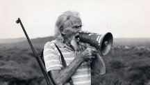 George Adamson pictured calling for Koretta the lion in the hope she would respond
