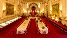 Staff prepare the Buckingham Palace ballroom for a lavish state banquet