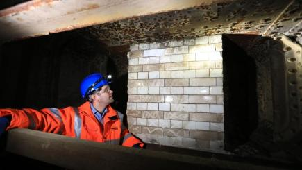 "Project manager Greg Thornett looks at the remains of Southwark Park station, a ""ghost"" station that closed a century ago (Network Rail/PA)"