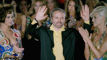 Gianni Versace is applauded by his models in 1991.