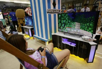 Girl in chair playing Minecraft