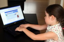 Girl playing with Dell laptop