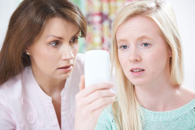 Girl talking to mum with phone