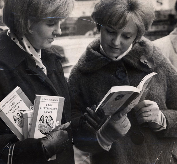 Office workers Doreen Potter and Sandra Raybaud peruse one of several copies of the book bought for their colleagues.