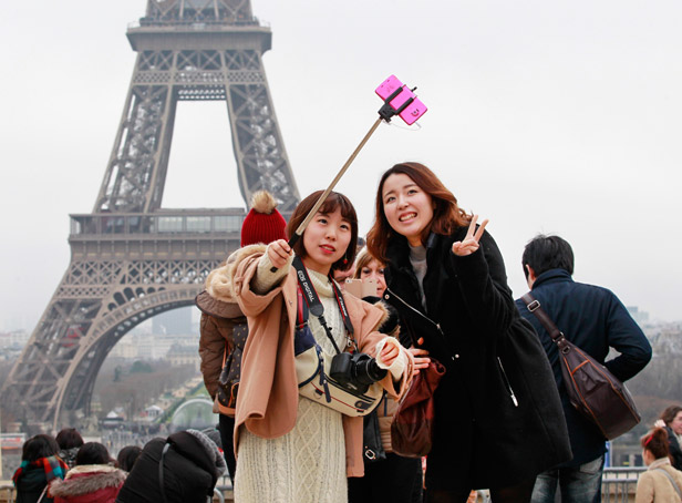 Girls using selfie stick in Paris