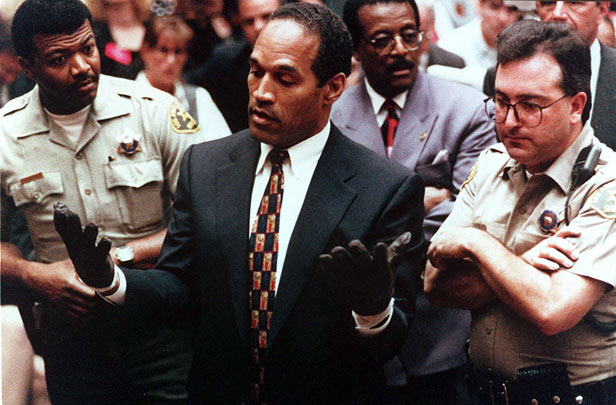 OJ Simpson tries on a pair of gloves in court on June 15, 1995.
