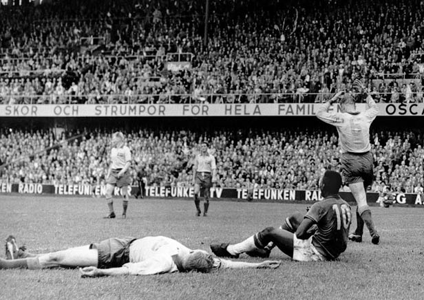Pele sits on the grass after scoring Brazil's fifth goal against Sweden in the closing minutes of the World Cup final.