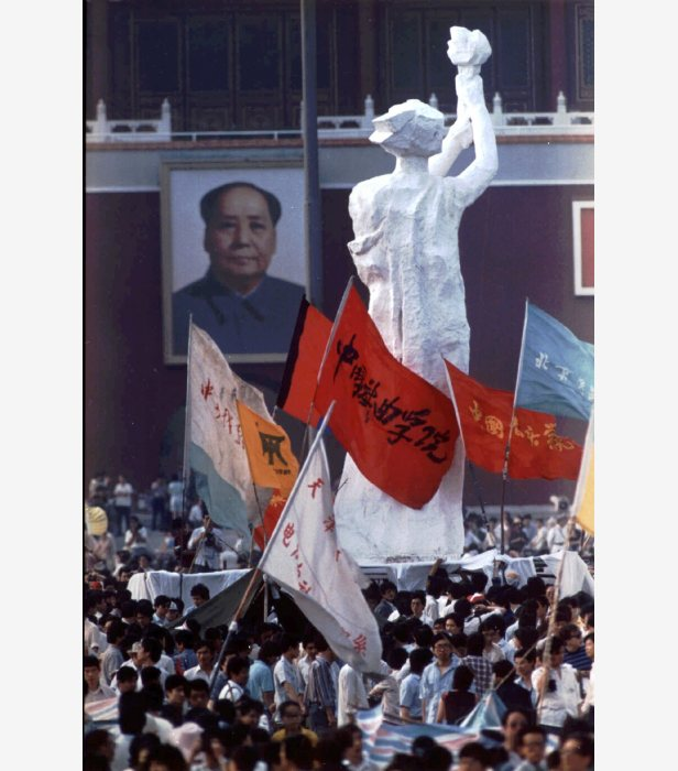 The portrait of Mao Zedong faces off a statue dubbed The Goddess of Democracy during the student protest on Tiananmen Square.