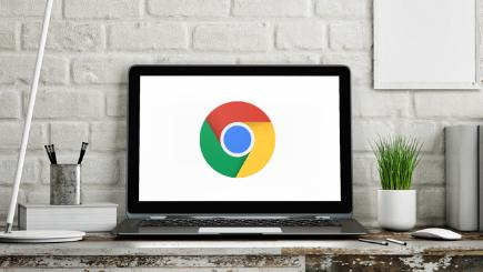 Laptop on desk with Google Chrome logo
