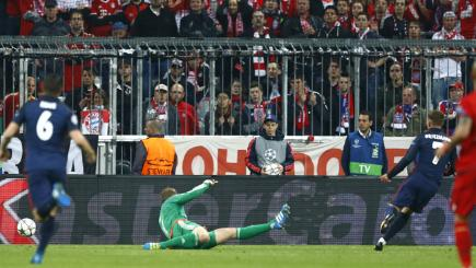 Atletico Madrid's Antoine Griezmann scores his side's goal in their 2-1 defeat to Bayern Munich in the Champions League.