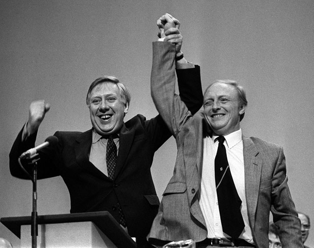 Neil Kinnock and Roy Hattersley celebrate being elected leader and deputy leader of the Labour Party.