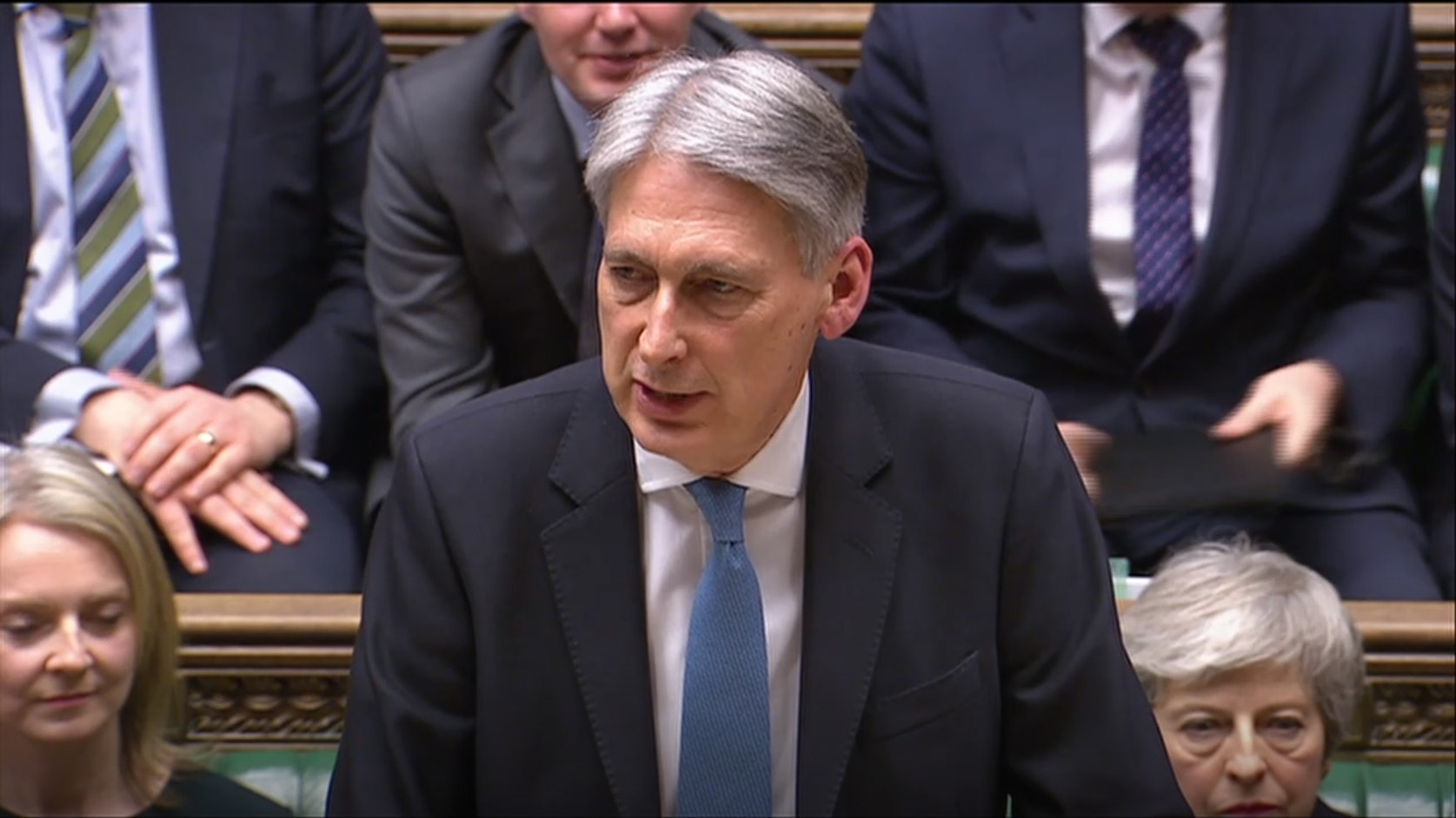 Hammond offers more spending, lower taxes if a Brexit deal is done