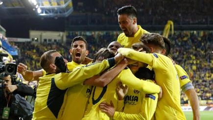 Villarreal players celebrate after scoring the opening goal in the Europa League semi final against Liverpool.
