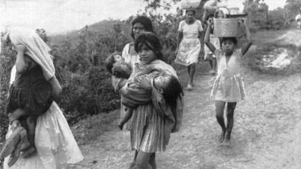 Honduran women and children rush towards the Guatemalan border 30 miles away after two days of artillery barrage by Salvadorean troops.