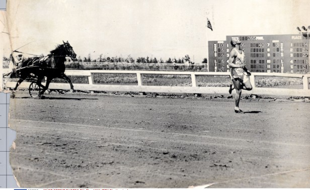 After turning professional, Owens ended up racing racehorses - here he is beating one rival by 10 yards.