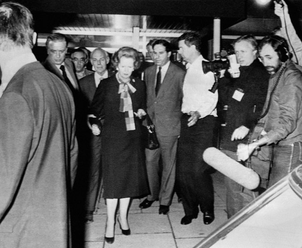 Margaret Thatcher and husband Denis leave the Grand Hotel following the bombing.